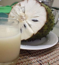 soursop fruit and a glass of juice