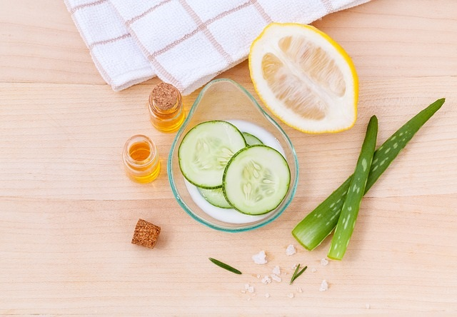 Lemons, aloe vera, and slices of cucumber for natural skin care.